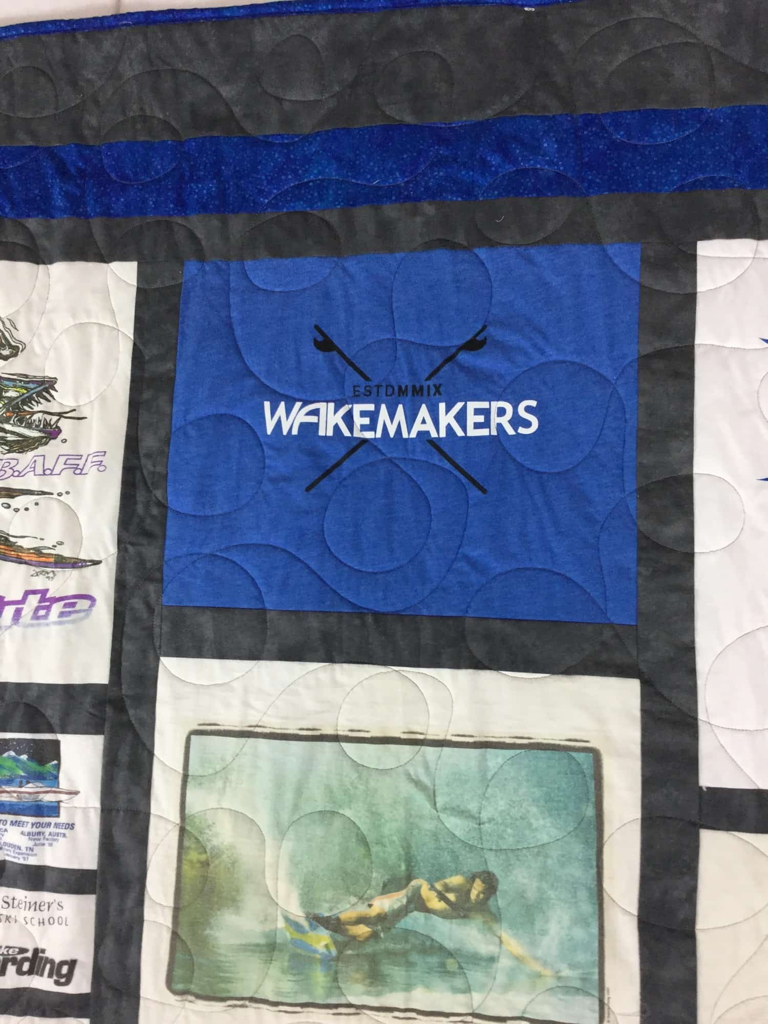 Image of an t-shirt quilt that I designed and sewed for a customer