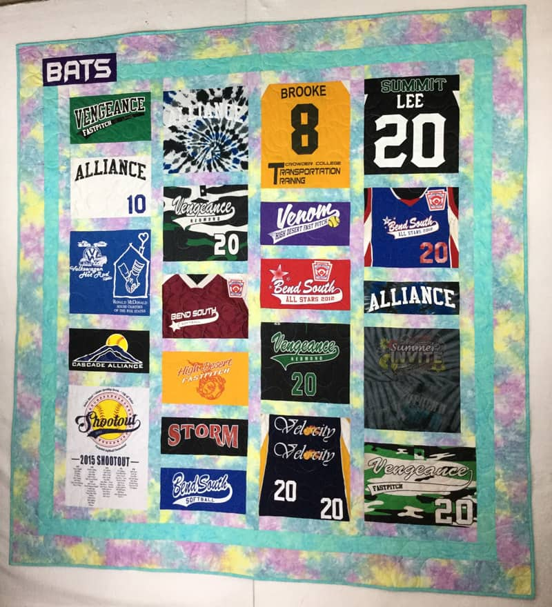 Image of a softball themed custom t-shirt quilt that I made for a customer